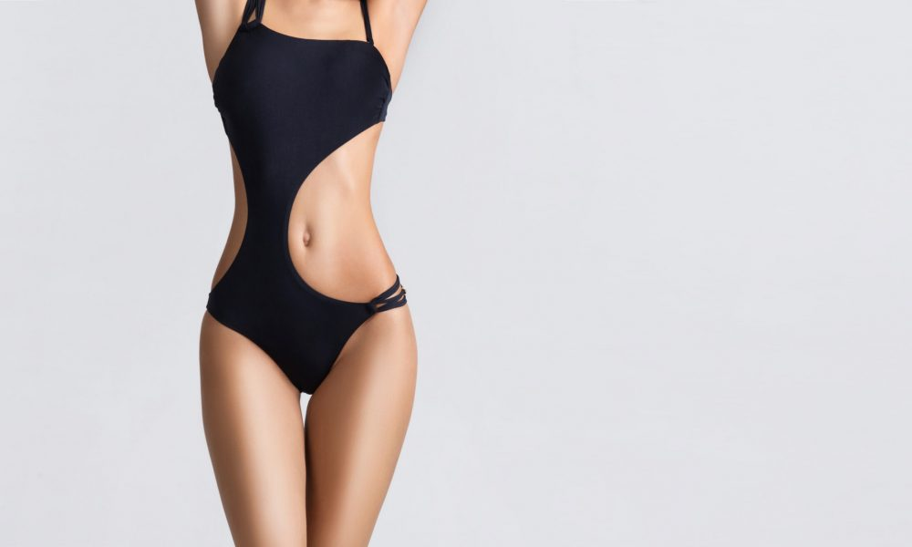Young, fit and beautiful woman in sporty swimsuit. Sport, diet, health and beauty concept.